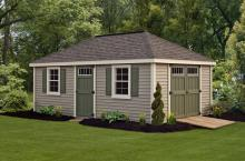 Deluxe Villa 12′ x 20′ • Clay vinyl siding, Navajo white trim, avocado green doors and shutters, slate architectural shingles. Options • Larger windows, shutters, extra side door, transom windows, ridge vent