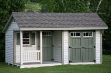 Deluxe Quaker 10′ x 16′ • Heritage grey vinyl siding, clay trim, avocado green doors and shutters, slate architectural shingles Options • Shutters, transom windows, gable vents, corner porch, single entrance door