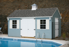 Standard Cape Cod 10′ x 16′ with slate blue vinyl siding and cupola