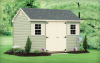 Standard Cape Cod 8′ x 16′ Sage vinyl siding, beige trim and shutters, black architectural shingles